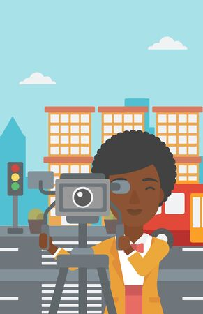 cinematographer: An african-american camerawoman looking through movie camera on a city background vector flat design illustration. Vertical layout. Illustration