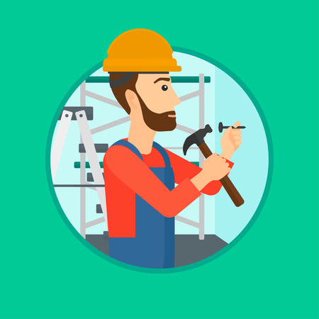 A hipster worker with the beard hammering a nail into the wall. Worker in overalls and hard hat nailing with hammer in apartment. Vector flat design illustration in the circle isolated on background.