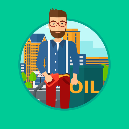 gas man: A hipster man with the beard standing near oil barrel. Man holding gas pump nozzle on a city background. Vector flat design illustration in the circle isolated on background.