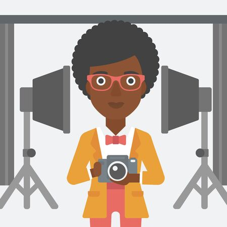 lighting equipment: An african-american woman holding a camera on the background of photo studio with lighting equipment vector flat design illustration. Square layout.