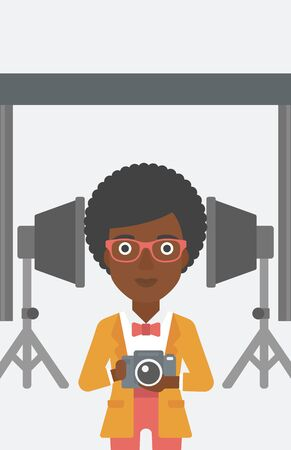 lighting equipment: An african-american woman holding a camera on the background of photo studio with lighting equipment vector flat design illustration. Vertical layout.