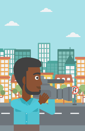 cinematograph: An african-american cameraman with video camera taking a video on a city background vector flat design illustration. Vertical layout. Illustration