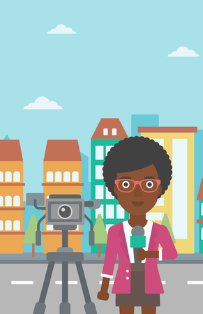 woman black background: A camera filming and an african-american  reporter standing with a microphone on a city background vector flat design illustration. Vertical layout.