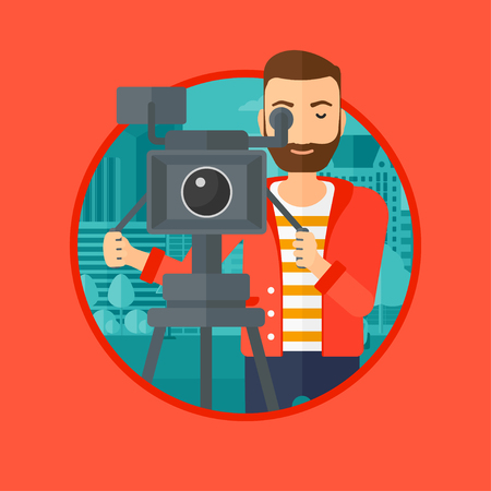 A hipster cameraman with the beard looking through movie camera on a tripod. Young man with professional video camera in the city. Vector flat design illustration in the circle isolated on background. 向量圖像