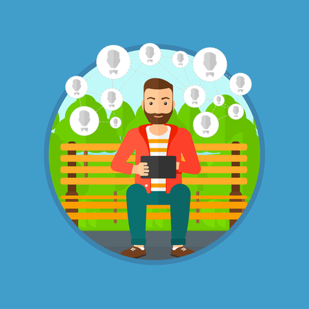 Hipster man sitting on a bench in the park and using a tablet computer with network avatar icons above. Social network concept. Vector flat design illustration in the circle isolated on background.