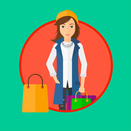 consumer goods: Woman holding shopping bags. Happy young woman carrying shopping bags. Woman with a lot of shopping bags. Vector flat design illustration in the circle isolated on background.