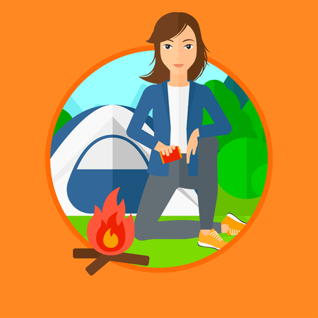 Woman kindling campfire on the background of camping site with tent. Tourist relaxing near campfire. Woman sitting near campfire. Vector flat design illustration in the circle isolated on background. 일러스트