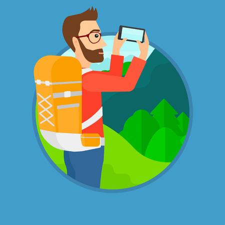 taking photo: A hipster man with the beard taking photo of landscape with mountains. Young man with backpack taking photo with his cellphone. Vector flat design illustration in the circle isolated on background.