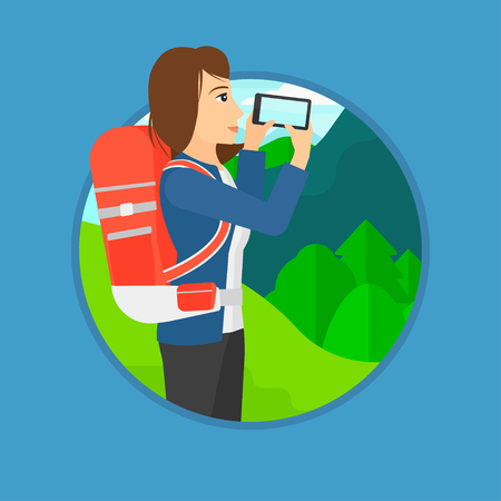 woman cellphone: Travelling woman taking photo of landscape with mountains. Young hiking woman with backpack taking photo with her cellphone. Vector flat design illustration in the circle isolated on background. Illustration