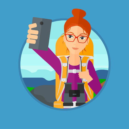woman cellphone: Young woman making selfie on the background of hilly countryside. Travelling woman with backpack taking photo with cellphone. Vector flat design illustration in the circle isolated on background. Illustration