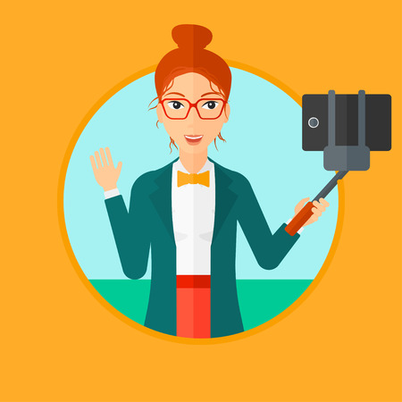 woman cellphone: Smiling woman making selfie with a selfie-stick. Woman taking photo with cellphone. Young woman taking selfie and waving. Vector flat design illustration in the circle isolated on background.