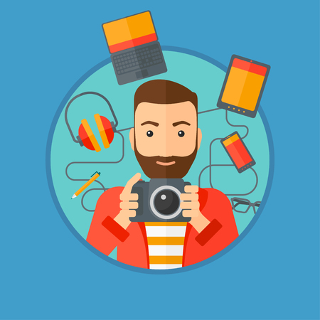 taking photo: Hipster man with the beard taking photo with digital camera. Young man surrounded with gadgets. Man using many electronic gadgets. Vector flat design illustration in the circle isolated on background. Illustration