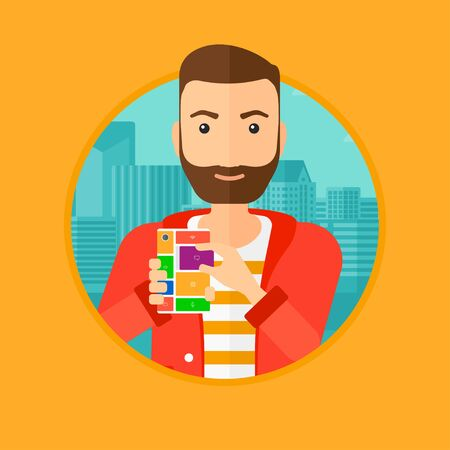 rebuild: A hipster man with the beard holding modular phone. Young man with modular phone on a city background. Man using modular phone. Vector flat design illustration in the circle isolated on background.