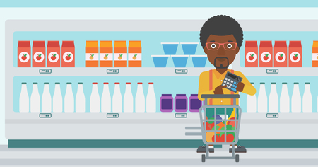 An african-american young man at the supermarket with calculator and supermarket trolley full with products. Man checking prices with calculator. Vector flat design illustration. Horizontal layout. Ilustración de vector