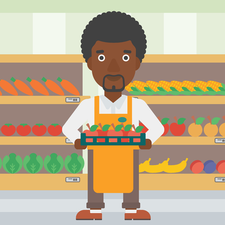 An african-american male supermarket worker holding a box with apples on the background of shelves with vegetables and fruits in supermarket. Vector flat design illustration. Square layout.