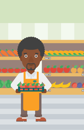 An african-american male supermarket worker holding a box with apples on the background of shelves with vegetables and fruits in supermarket. Vector flat design illustration. Vertical layout.