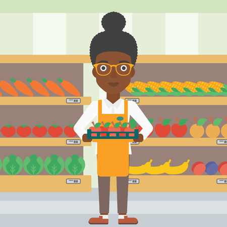 An african-american female supermarket worker holding a box with apples on the background of shelves with vegetables and fruits in supermarket. Vector flat design illustration. Square layout.
