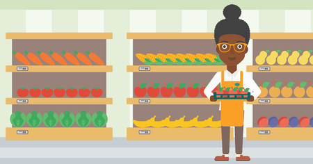 An african-american female supermarket worker holding a box with apples on the background of shelves with vegetables and fruits in supermarket. Vector flat design illustration. Horizontal layout. Vettoriali