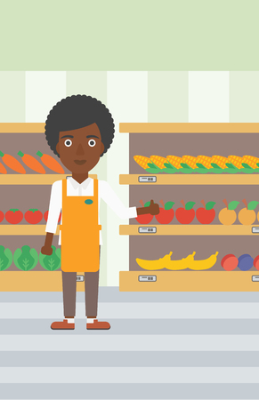 An african-american female supermarket worker showing thumb up on the background of shelves with vegetables and fruits in supermarket. Vector flat design illustration. Vertical layout. 向量圖像
