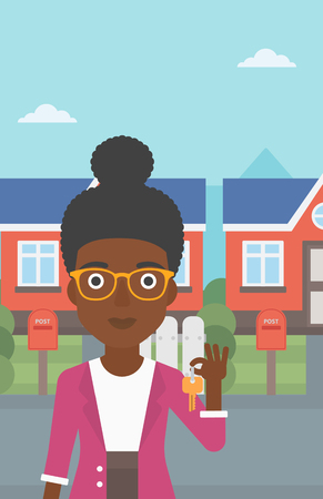 Young female real estate agent holding key. An african-american woman with keys standing in front of the house. Happy new owner of a house. Vector flat design illustration. Vertical layout.