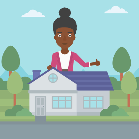 An african-american woman standing behind the house and showing thumb up. Female real estate agent offering the house. Young woman giving thumb up. Vector flat design illustration. Square layout.