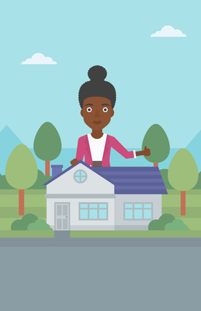 An african-american woman standing behind the house and showing thumb up. Female real estate agent offering the house. Young woman giving thumb up. Vector flat design illustration. Vertical layout. 向量圖像