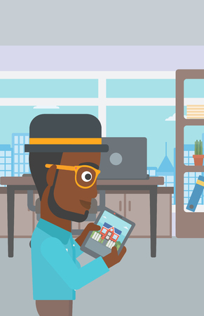 An african-american man looking at house on a digital tablet screen. Young man standing in office and looking for house on tablet computer. Vector flat design illustration. Vertical layout.