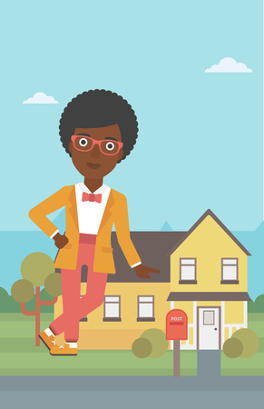 An african-american female real estate agent standing near the house. Real estate agent leaning on the house. Real estate agent offering house. Vector flat design illustration. Vertical layout. 向量圖像