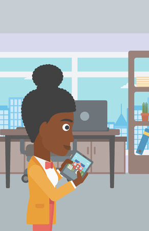 An african-american woman looking at house on a digital tablet screen. Young woman standing in office and looking for house on tablet computer. Vector flat design illustration. Vertical layout. Ilustração