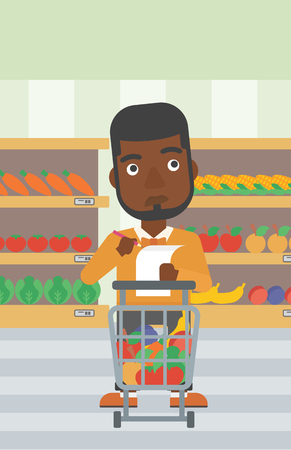 An african-american thoughtful man standing at the supermarket with supermarket trolley full with products and holding a shopping list in hands. Vector flat design illustration. Vertical layout. 向量圖像