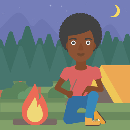 kindle: An african-american woman kindling campfire on the background of camping site with tent. Tourist relaxing near campfire. Woman sitting near campfire. Vector flat design illustration. Square layout.