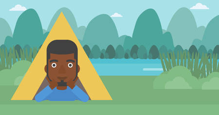 An african-american man crawling out from a camping tent. Man with his hands on cheek lying in camping tent and relaxing. Vector flat design illustration. Horizontal layout. Vettoriali