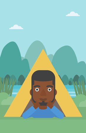 cheek: An african-american man crawling out from a camping tent. Man with his hands on cheek lying in camping tent and relaxing. Vector flat design illustration. Vertical layout.