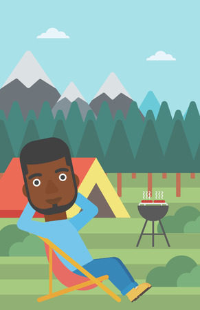 An african-american man sitting in a folding chair in the camp. Man relaxing and enjoying his camping holiday near the tent. Vector flat design illustration. Vertical layout.