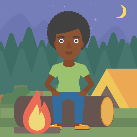 camping site: An african-american woman sitting on a log near a fire on a background of camping site with tent. Woman sitting near a campfire at a campsite. Vector flat design illustration. Square layout.