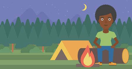 camping site: An african-american woman sitting on a log near a fire on a background of camping site with tent. Woman sitting near a campfire at a campsite. Vector flat design illustration. Horizontal layout.