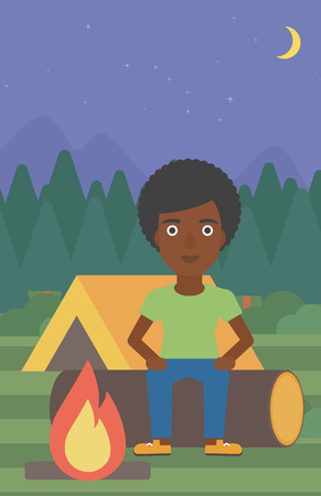 campsite: An african-american woman sitting on a log near a fire on a background of camping site with tent. Woman sitting near a campfire at a campsite. Vector flat design illustration. Vertical layout.