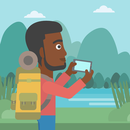 taking photo: An african-american man taking photo of landscape with mountains. An african-american man with backpack taking photo with his cellphone. Vector flat design illustration. Square layout.
