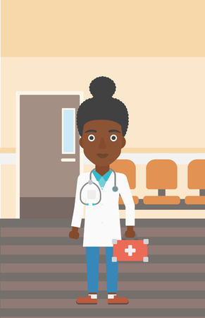 hospital corridor: An african-american young female doctor in uniform with first aid kit standing in the hospital corridor. Vector flat design illustration. Vertical layout.