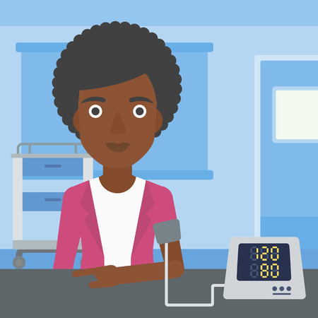 An african-american woman taking care of her health and checking her blood pressure with digital meter. Vector flat design illustration. Square layout.