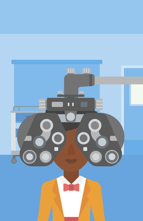 An african-american woman undergoing an eye examination while visiting optometrist at the medical office. Vector flat design illustration. Vertical layout.