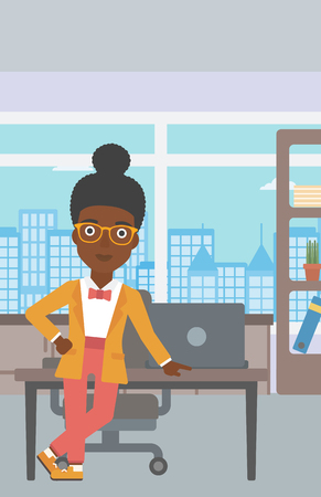 business woman standing: An african-american young business woman leaning on a table in the office. Young smiling business woman standing in the office. Vector flat design illustration. Vertical layout.