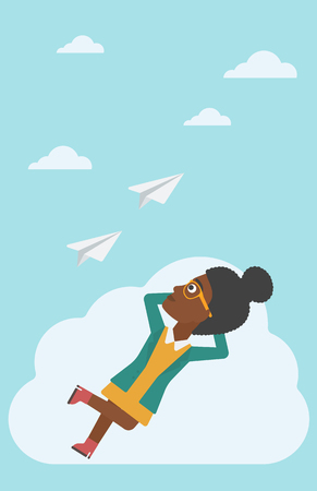 flying paper: An african-american business woman lying on a cloud and looking at flying paper plane. Business woman relaxing on a cloud. Vector flat design illustration. Vertical layout.