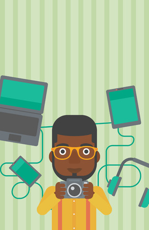 taking photo: An african-american man taking photo with digital camera. Man surrounded with gadgets. Man using many electronic gadgets. Vector flat design illustration. Vertical layout.