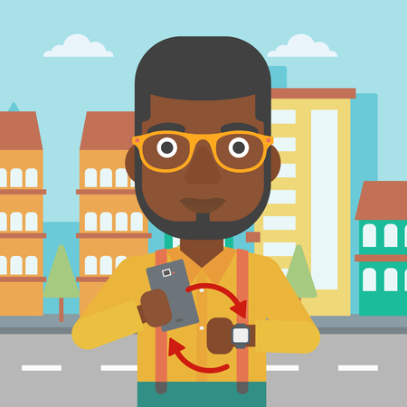 An african-american man holding smartphone and looking at his smart watch. Synchronization between smartwatch and smartphone. Vector flat design illustration. Square layout.