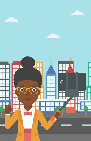 woman cellphone: An african-american woman making selfie with a selfie-stick. An african-american woman taking photo with cellphone and waving on a city background. Vector flat design illustration. Vertical layout.
