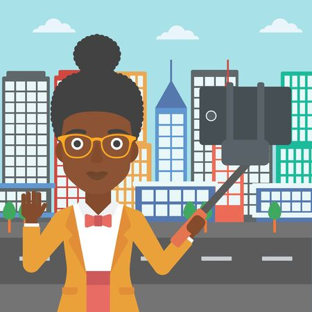 woman cellphone: An african-american woman making selfie with a selfie-stick. An african-american woman taking photo with cellphone and waving on a city background. Vector flat design illustration. Square layout. Illustration
