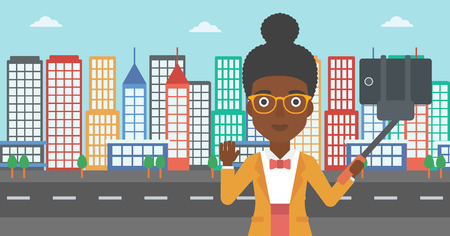 woman cellphone: An african-american woman making selfie with a selfie-stick. An african-american woman taking photo with cellphone and waving on a city background. Vector flat design illustration. Horizontal layout. Illustration