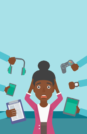An african-american woman in despair and many hands with gadgets around her. Woman surrounded with gadgets. Woman using many electronic gadgets. Vector flat design illustration. Vertical layout.