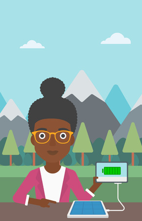 woman tablet: An african-american woman charging tablet computer with solar panel on a background of mountains. Charging digital tablet from portable solar panel. Vector flat design illustration. Vertical layout.